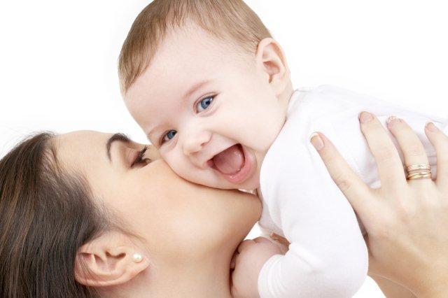 mom-kissing-baby